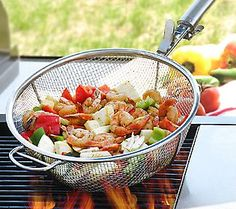 Shake, stir, mix, and toss fresh veggies and shrimp together on the grill with this BBQ basket. Simple!