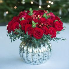 PLEASE NOTE: This arrangement is part of our Christmas Flower Collection and is only available for delivery from the to December. You can view the full Christmas Collection here. This stunning red Christmas arrangement is made with the velvet Christmas Flower Arrangements, Christmas Flowers, Christmas Table Decorations, Red Christmas, Floral Arrangements, Christmas Ideas, Roses Luxury, Christmas Cocktail Party, Flower Company