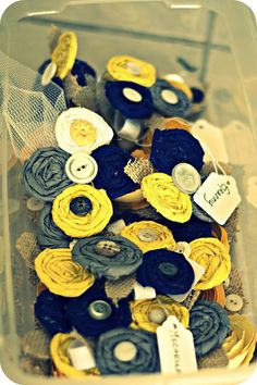 blue & yellow... these would make great favors at a wedding.... they could pin them on their shirt or in their hair