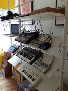 this is my standing studio using ikea stolmen system to rack my synths and drum machines.