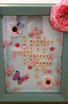 Mothers Day present we made with her children's and grandchildrens names  using scrabble tiles and a shadow box frame