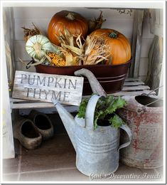 #Fall #porch decorating with watering cans -                                                                                                                                                     More