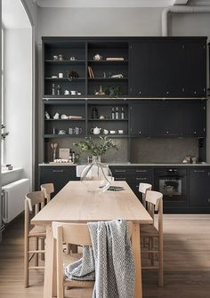 This beautiful Swedish apartment by Oscar Properties combines a New York loft feel with warm Scandinavian minimalism. Featuring original windows and high ceilings, the expansive interior exudes elegan