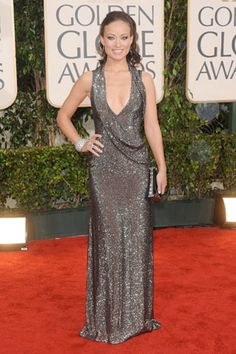 Olivia Wilde was dripping in liquid gunmetal Gucci and looked smoldering with that smokey eye makeup.  I loved this look for the 2010 Golden Globes.