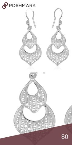 🆕 Drop 925 Sterling Silver Earrings Ornate Design Shaped with classic ethnic motifs, these earrings suit any casual attire for a compelling look. Made in sterling silver, the pieces are decorated with ornate openwork. Metal Color White Metal 925 Sterling Silver Total Weight (grams) 3.212 Product Specifications Finish Standard Product Weight (grams) 3.212 Metal Purity 925S Metal Color White Metal 925 Sterling Silver Total Weight (grams) 3.212 Retail $69 Jewelry Earrings