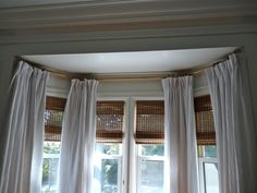 Elegant Interior Design With Bay Window Curtain Rod: Interesting Bay Window Curtain Rod With Roman Blinds And White Curtain