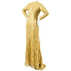 Preowned Zuhair Murad Haute Couture Metallic Gold Lace High Neck Long... ($6,900) ❤ liked on Polyvore featuring dresses, gowns, aesthetic evening dresses, gold, long dresses, long sleeve dress, long sleeve evening dresses, long sleeve lace evening gown and long-sleeve lace dress