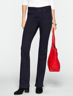 """Talbots  Slimming Heritage Midnight Wash Bootcut Jeans  Classic, go-everywhere jeans: our best selling-fit in a bootcut silhouette, designed with a tummy-control slimming panel for a great shape. Sit comfortably at waist with a straight cut through hip and thigh Slimming inside panel for tummy control Five-pocket styling Color Midnight Size 10L Inseam: Misses Long 35"""" 99% cotton/1% spandex Machine wash Imported C592488 Retail $89.50              57"""