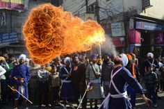 Birthday blast This fire-breathing act is part of a procession to the Golden Temple in Amritsar, India, on Nov. 27, the eve of the 543rd birthday of Sri Guru Nanak, the founder of the Sikh religion.   • Follow NBC News Pictures on twitter