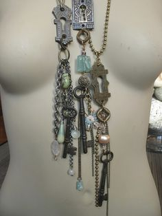 I created these necklaces, with vintage keys, keyhole hardware, vintage beads, semi precious stones and pearlized agate.  www.hotrocksglassjewels.blogspot.com