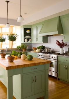 never thought about a green kitchen, but this is cute! :]