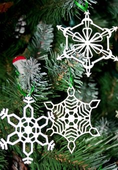 Laser-cut Christmas decorations from Atelier Fabry-Pérot. (They have an Etsy shop.)