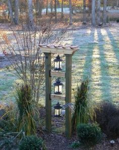 Tower of lights. Add solar lanterns and you have a summertime eye catcher in your garden. Replace with bird feeders during winter time and you'll create a bird magnet.Good idea, back yard Garden Deco, Terrace Garden, Garden Water, Bamboo Garden, Garden Shop, Solar Lanterns, Solar Lights, Path Lights, Hanging Lanterns