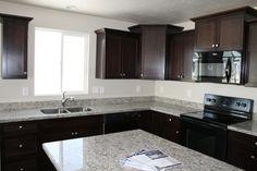 Kitchens | Liberty Homes | The Vistas community Dark maple cabinets, granite countertops and more!