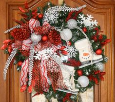 Christmas whimsical winter wreath / ice skates by ThePetalPeddlers