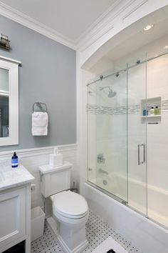 Nantucket Shingle Style Beachside transitional-bathroom.  Like this tile floor, the white wainscoting and gray walls.