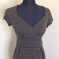 """Banana Republic houndstooth dress Classic with some va-va-voom! An all-time favorite dress of mine. If this fit, I would keep it forever. Nips waist beautifully and portrait neckline begs for a statement necklace. Great with or without blazer. The best part--no zipper! Shell 90% rayon/9% nylon/1% spandex and lining 100% polyester. Will keep its color and shape. Shoulder to bottom hem 43.25"""", chest 15.25"""" across, waist 13.25"""" across. Banana Republic Dresses Midi"""