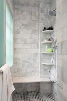 Marble tile shower with bench and sprayer is a great move for the #aginginplace #silverspaces