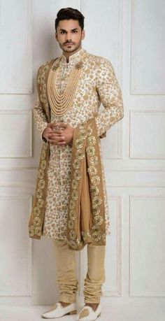 Indian Wedding Groom Sherwani: Brilliant Indian Groom / Desi Groom and his Sherwani with churidar, stole and pearl groom necklace, in creams and beige (though the fit is bit too tight) Indian Wedding Suits Men, Sherwani For Men Wedding, Wedding Outfits For Groom, Sherwani Groom, Indian Wedding Couple, Wedding Dress Men, Indian Wedding Outfits, Wedding Groom, Punjabi Wedding