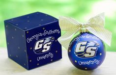 Any fan will love this Georgia Southern Logo Ornament. You'll be proud to showcase your school pride during the holiday season with this spirited ornament featuring the Georgia Southern logo and school colors! Each ornament is perfectly packaged with a matching gift box and coordinating tied ribbon for easy gift giving and safe storage.
