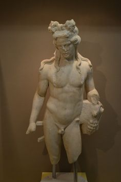 "(Thessaloniki) Museum of the Roman Forum:  From the temporary exhibition ""…young and in excellent health"", Aspects of youths' life in ancient Macedonia.  Statue of Dionysus, god of theater, grapes and wine. (Roman period)...."