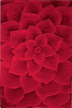 """Our popular Metropolitan Collection of contemporary rugs features plush and dense designs with a generous 1/2""""-thick pile. Pointed petals seem to blossom from the center of th"""