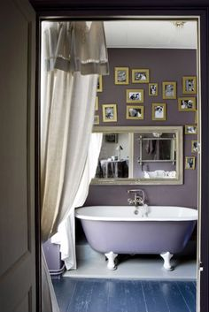 A great example of how a claw foot tub exterior can be painted to match your bathroom to help bring all things together.