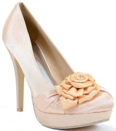 Add a classy touch to your wardrobe with this elegant womens platform pump. The satin fabric upper provides added sheen, while the platform and Lovely rose on the toebox proudly display feminine charm