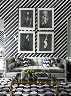 Graphic to the max. Diagonal stripe wallpaper, graphic wave rug and a black and white living room color scheme.