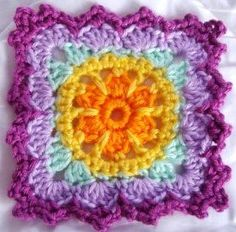 Beautiful granny square with beautiful colors! ¯\_(ツ)_/¯ Pattern is for a Granny Square Floral Scarf here: http://www.lionbrand.com/patterns/cwe-floralscarf.html?noImages=