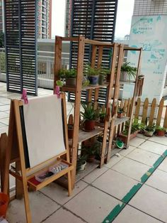 Outdoor art area - we need to integrate our easels into an environment