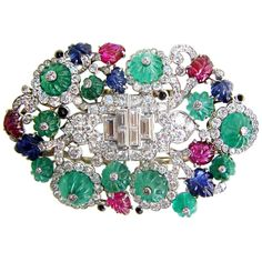 """Henri Picq Art Deco """"Tutti Frutti"""" Double Clips. An exceptional set with diamonds, carved emeralds, rubies & sapphires, & cabochon onyx. Mounted in platinum. Paris, circa 1925."""