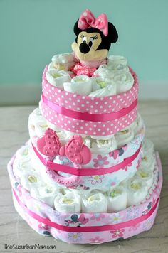 Easy step-by-step diaper cake tutorial with lots of pictures to show you how to make a Minnie Mouse Diaper Cake using Disney Baby items from Walmart.