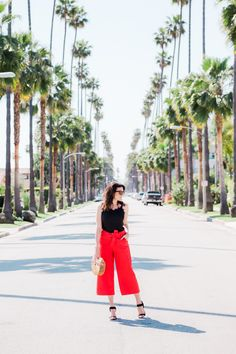 bright red cropped trousers and black cami