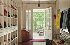 Mudrooms can be key for keeping your home organized. With racks for shoes, hooks for jackets and catchall storage, they keep the rest of the house looking decluttered and clean. If you're desiring an efficient space like this, be sure to browse through these mudrooms and transitional entries, in styles from farmhouse to modern.