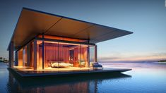 Designed by architect Dymitr Malcew, Floating House is a mobile house can be easily docked at a marina or pier. The concept of the floating house is inspired by Architecture Durable, Architecture Design, Residential Architecture, Floating Architecture, Concrete Architecture, Amazing Architecture, Mos Architects, Floating House, Floating Boat