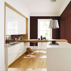 This white and wood handleless kitchen design is the Remo range from Second Nature. A light peninsular is created with a floating wooden worktop, keeping the design light and airy but creating that all-imporant place to sit. http://www.housetohome.co.uk/product-idea/picture/kitchen-unit-doors-10-of-the-best/7#6YIOOOir1BvJZURD.32