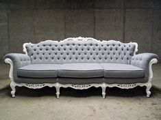 Modern Victorian couch. Love the gray and white. These ideas are getting me excited about the possibility of re-purposing old, beautiful, but sluggish furniture. How awesome would this be in the pink Victorian house?