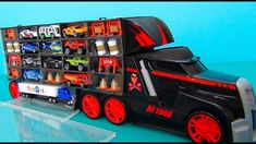 Mega Huge Truck. Toy Truck with many cars inside. Truck with a Racing Tr...