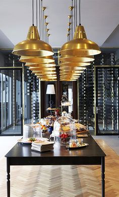 Black and gold spectacular glass walls house a wine cellar. Commercial Design, Commercial Interiors, South Shore Decorating, Colored Ceiling, Hospitality Design, Wine Storage, Restaurant Design, House Restaurant, Retail Design