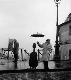 Robert Doisneau, Le violoncelle sous la pluie, Paris  1957