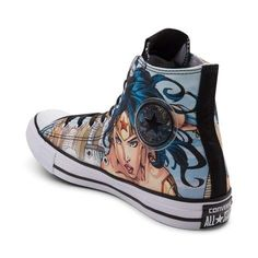Showcase the beauty, brains, and brawn of the most iconic heroine of all time, with the new Chuck Taylor All Star Hi Wonder Woman Sneaker from Converse! Suit up with star-spangled style and these Wonder Woman Chucks, featuring a high-top silhouette with Wonder Woman-themed graphics, and signature Converse logo patch. <b>Available only at Journeys!</b>  <br><br><u>Features include</u>:<br> > High top style constructed with graphic printed...