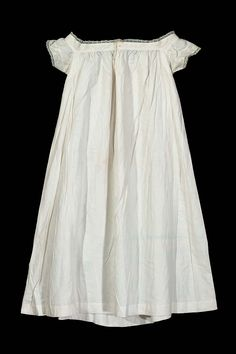 Mid-19th-c. linen chemise with very fine whitework embroidery and lace trim. American. MFA.