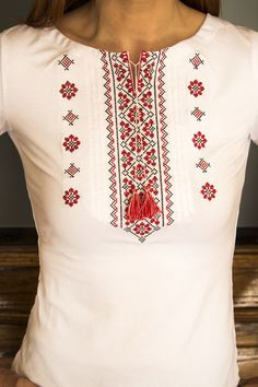Stylish and contemporary shirt with real cross-stitch embroidery. Very soft, silky, stretchable material.  Viscose 95% Lycra 5% Made in Ukraine