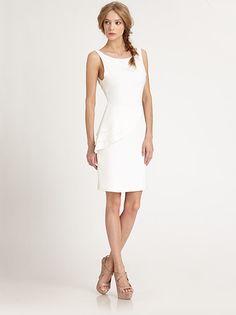 beautiful white dress. love her hair too.