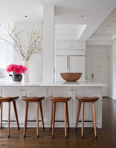wood stools + white marble kitchen by wettling architects