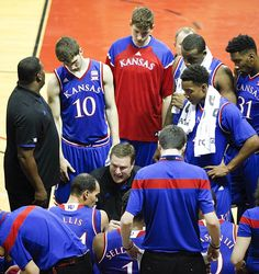 Kansas head coach Bill Self goes over the game plan with his players during a timeout in the first half on Thursday, Nov. 27, 2014 at the HP Field House in Kissimmee, Florida. #KU