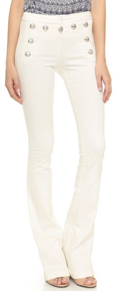 These Slim Veronica Beard flares make a nautical statement with embossed metal button along the sailor front and are the the quintessential yoga style pants that don't scream I'm going to the gym.