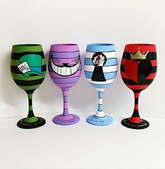 Set of four hand painted Wonderland wine glasses. Mad Hatter, Alice, Red Queen and Cheshire Cat.  Freehand painted and coated with Acrylic gloss sealer. I recommend hand washing only to prolong life of painting. It is safe to drink so add your favorite wine and bottoms up!  Made to Order, Please allow 3-5 days for these to be completed and shipped.  NOTE TO BUYER..  Because our wine glasses are hand painted and sealed with an Acrylic sealer, Please hand wash only with a non-abrasive sponge…