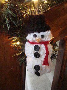 Make an #EasyCrochetSnowmanOrnament for the holidays. Hang this cute guy on your tree or give it as a gift. Chaining is the only thing required for the #crocheted part of this snowman; even your kids can help!
